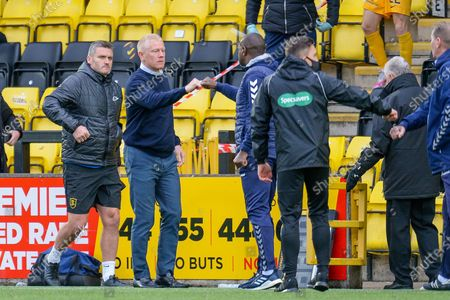 Stock Image of Livingston manager Gary Holt fist pumps with Kilmarnock manager, Alex Dyer after the final whistle of the SPFL Premiership match between Livingston and Kilmarnock at The Tony Macaroni Arena, Livingston