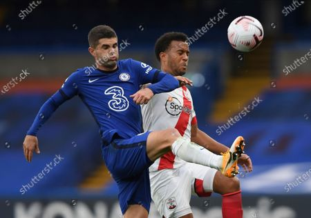 Stock Photo of Chelsea's Christian Pulisic, left, and Southampton's Ryan Bertrand challenge for the ball during the English Premier League soccer match between Southampton and Chelsea at the Stamford Bridge in London, England