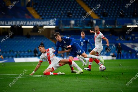 Chelsea's Kai Havertz, center,challenge for the ball with Southampton's Jan Bednarek, left, and Oriol Romeu during the English Premier League soccer match between Southampton and Chelsea at the Stamford Bridge in London, England
