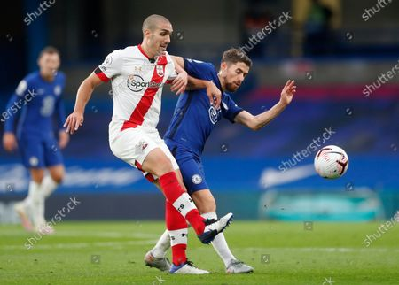 Chelsea's Jorginho, right, and Southampton's Oriol Romeu challenge for the ball during the English Premier League soccer match between Southampton and Chelsea at the Stamford Bridge in London, England