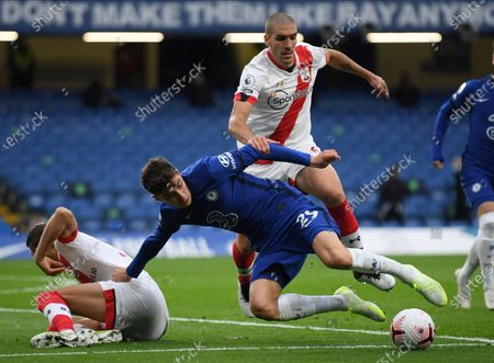 Chelsea's Kai Havertz, center, challenge for the ball with Southampton's Jan Bednarek, left, and Oriol Romeu during the English Premier League soccer match between Southampton and Chelsea at the Stamford Bridge in London, England