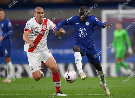 Southampton's Oriol Romeu, left, and Chelsea's N'Golo Kante challenge for the ball during the English Premier League soccer match between Southampton and Chelsea at the Stamford Bridge in London, England