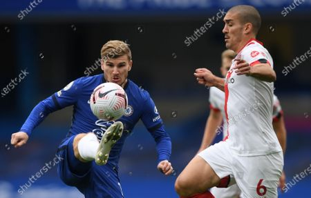 Timo Werner (L) of Chelsea in action against  Oriol Romeu of Southampton during the English Premier League match between Chelsea and Southampton in London, Britain, 17 October 2020.
