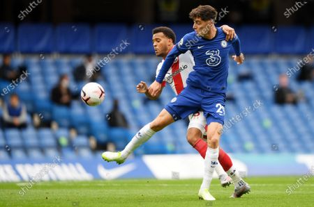Kai Havertz (R) of Chelsea in action against Ryan Bertrand of Southampton during the English Premier League match between Chelsea and Southampton in London, Britain, 17 October 2020.