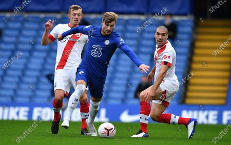Timo Werner (C) of Chelsea shakes off Oriol Romeu (R) and James Ward-Prowse of Southampton to score the opening goal during the English Premier League match between Chelsea and Southampton in London, Britain, 17 October 2020.
