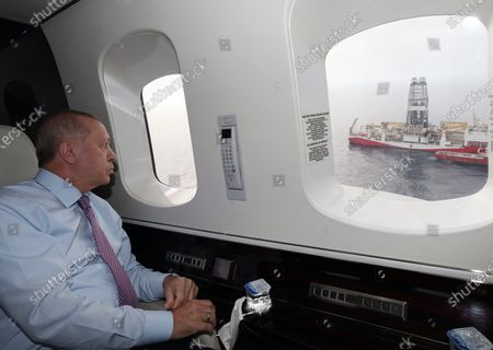 A handout photo made available by the Turkish President Press Office shows Turkish President Recep Tayyip Erdogan  looks from his helicopter window to the  Turkish drilling vessel Fatih in Zonguldak, Turkey, 17 October 2020. Turkish President Erdogan on 21 August 2020 has announced that Turkey discovered the biggest natural gas field in Turkish history in the Black Sea.