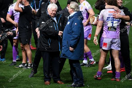 Tony Rowe shakes hands with Jacky Lorenzetti after the final whistle of the match