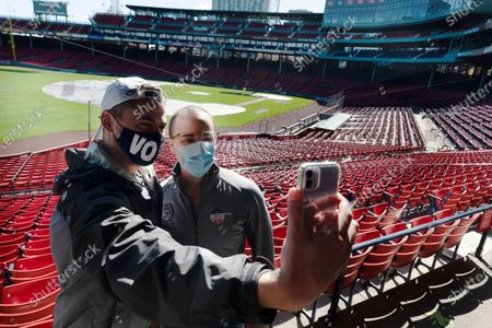 Stock Picture of Derek Martin, left, and Casey Bishop take a selfie after voting at Fenway Park, in Boston