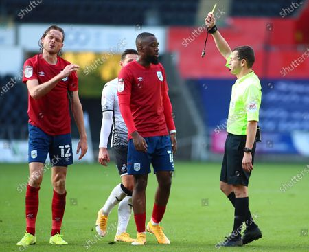 Richard Stearman of Huddersfield Town is shown a yellow card for a foul in the second half; Liberty Stadium, Swansea, Glamorgan, Wales; English Football League Championship Football, Swansea City versus Huddersfield Town.