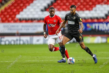 Charlton Athletic forward Omar Bogle (17) and Wigan Athletic defender Danny Fox (4) during the EFL Sky Bet League 1 match between Charlton Athletic and Wigan Athletic at The Valley, London