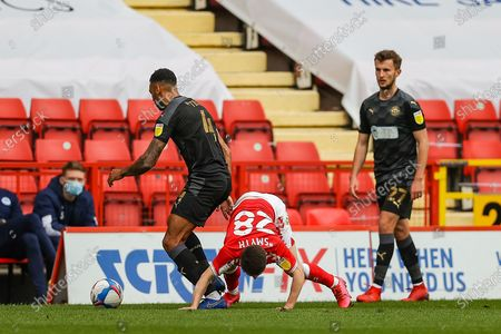 Charlton Athletic Paul Smyth (28) and Wigan Athletic defender Danny Fox (4) battle for ball during the EFL Sky Bet League 1 match between Charlton Athletic and Wigan Athletic at The Valley, London