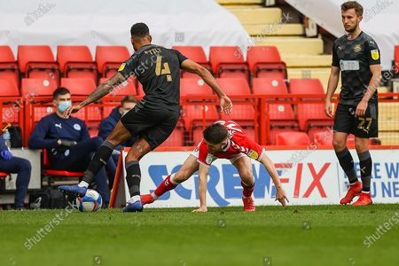 Stock Image of Charlton Athletic Paul Smyth (28) and Wigan Athletic defender Danny Fox (4) battle for ball during the EFL Sky Bet League 1 match between Charlton Athletic and Wigan Athletic at The Valley, London