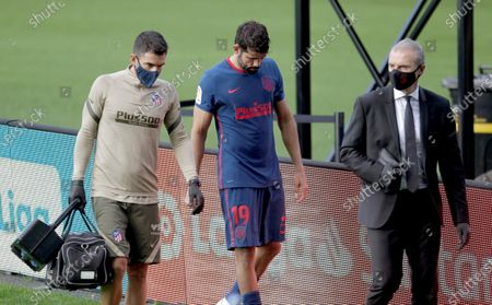 Atletico Madrid's striker Diego Costa (C) leaves the pitch after getting injured during the Spanish LaLiga Primera Division soccer match Celta vs Atletico Madrid played at Balaidos stadium in Vigo, Spain, 17 October 2020.