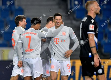 Stock Image of From left, Bayern's scorer Thomas Mueller, Serge Gnabry, Benjamin Pavard and Robert Lewandowski celebrate their side's fourth goal during the German Bundesliga soccer match between Arminia Bielefeld and FC Bayern Munich in Bielefeld, Germany