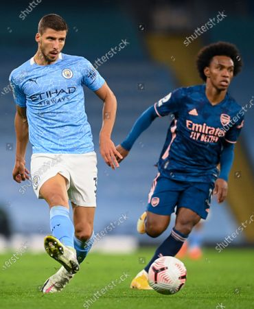 Ruben Dias (L) of Manchester City in action during the English Premier League soccer match between Manchester City and Arsenal FC in Manchester, Britain, 17 October 2020.