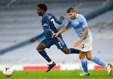 Bukayo Saka (L) of Arsenal in action against Ruben Dias (R) of Manchester City during the English Premier League soccer match between Manchester City and Arsenal FC in Manchester, Britain, 17 October 2020.