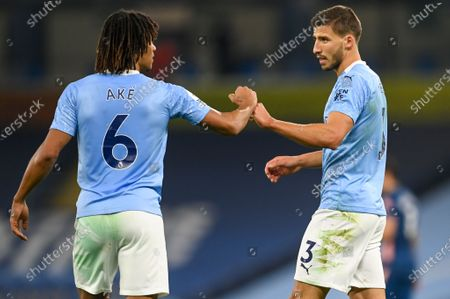 Manchester City players Ruben Dias (R) and Nathan Ake (L) react during the English Premier League soccer match between Manchester City and Arsenal FC in Manchester, Britain, 17 October 2020.