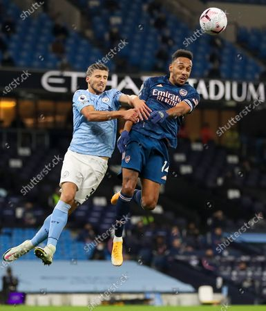 Ruben Dias (L) of Manchester City in action against Pierre-Emerick Aubameyang (R) of Arsenal during the English Premier League soccer match between Manchester City and Arsenal FC in Manchester, Britain, 17 October 2020.