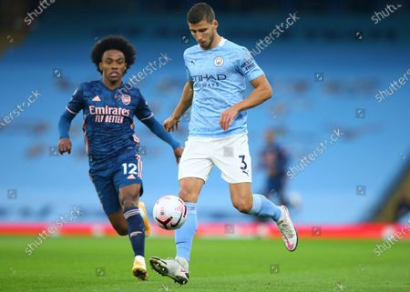 Willian (L) of Arsenal in action against Ruben Dias (R) of Manchester City during the English Premier League soccer match between Manchester City and Arsenal FC in Manchester, Britain, 17 October 2020.