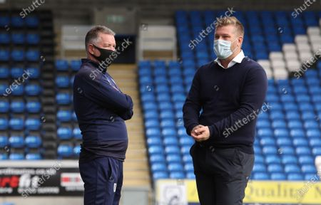 Peterborough United Manager Darren Ferguson talks with Oxford United manager Karl Robinson before the match