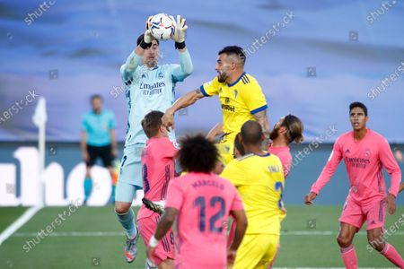 Thibaut Courtois of Real Madrid and Alvaro Negredo of Cadiz in action during the spanish league, La Liga Santander, football match played between Real Madrid and Cadiz CF at Alfredo Di Stegfano stadium on October 17, 2020 in Madrid, Spain.