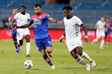 Al-Shabab's player Hassan Altambakti (R) in action against Abha's Muath Afaneh (L) during the Saudi Professional League soccer match between Al-Shabab and Abha at Prince Faisal Bin Fahd Stadium in Riyadh, Saudi Arabia, 17 October 2020.
