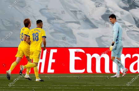 Cadiz CF's midfielder Alex Fernandez (L) and striker Alvaro Negredo (2-L) celebrate the 0-1 goal scored by striker Anthony Lozano (unseen) next to Real Madrid's goalkeeper Thibaut Courtois (R) during the Spanish LaLiga soccer match between Real Madrid and Cadiz CF held at Alfredo Di Stefano stadium, in Madrid, central Spain, 17 October 2020.