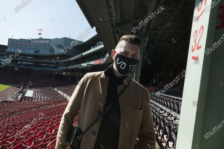 Nick Diamond leaves overlooking the field after voting at Fenway Park, in Boston