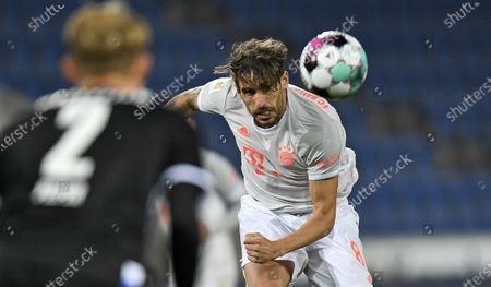 Bayern's Javi Martinez kicks the ball during the German Bundesliga soccer match between Arminia Bielefeld and Bayern Munich in Bielefeld, Germany