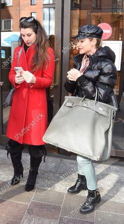Stock Image of Bianca Bowie-Phillips and Elen Rivas departing Harrod's