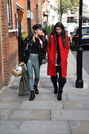 Stock Photo of Bianca Bowie-Phillips and Elen Rivas departing Harrod's