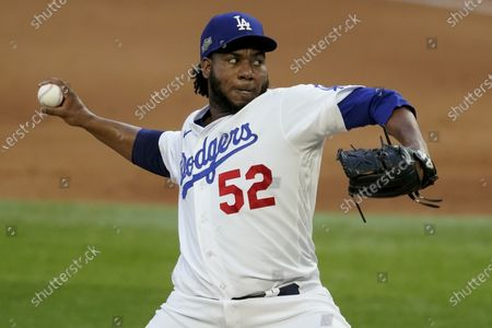 Los Angeles Dodgers relief pitcher Pedro Baez throws against the Atlanta Braves during the eighth inning in Game 6 of a baseball National League Championship Series, in Arlington, Texas