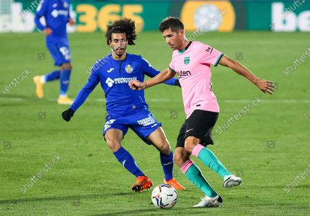 Marc Cucurella of Getafe CF and Sergi Roberto of FC Barcelona fight for the ball during the spanish league,  La Liga, football match played between Getafe CF and FC Barcelona at Coliseum Alfonso Perez on October 17, 2020 in Getafe, Madrid, Spain.