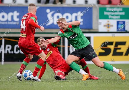 Stock Picture of Cliftonville vs Glentoran. Cliftonville's Garry Breen and Glentoran's Andrew Mitchell