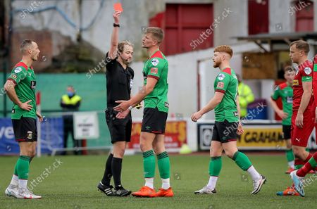 Cliftonville vs Glentoran. Glentoran's Cameron Stewart is shown a red card by referee Keith Kennedy