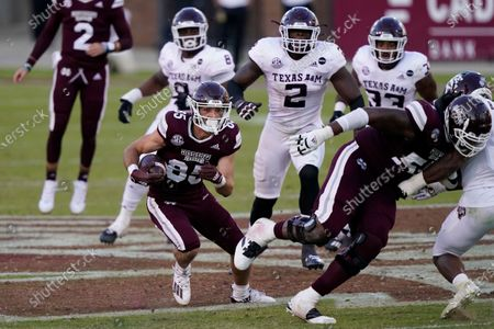 Stock Picture of Mississippi State wide receiver Austin Williams (85) follows a block by offensive lineman Greg Eiland (55) as he heads upfield with a first down pass reception during the second half of an NCAA college football game in Starkville, Miss