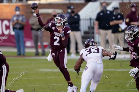 Mississippi State quarterback Will Rogers (2) passes under pressure from Texas A&M linebacker Aaron Hansford (33) during the second half of an NCAA college football game in Starkville, Miss