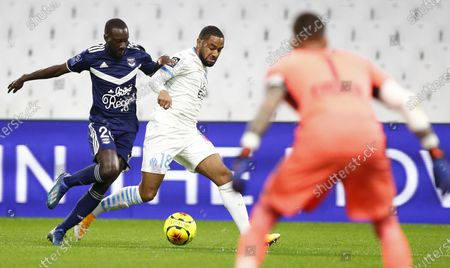 Olympique Marseille's Jordan Amavi (C) and Girondins Bordeaux's Youssouf Sabaly (L) in action during the French Ligue 1 soccer match between Olympique Marseille and Bordeaux at Orange Velodrome stadium in Marseille, France, 17 October 2020.