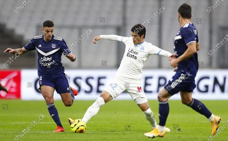 Olympique Marseille's Hikori Sakai (C) and Girondins Bordeaux's Hatem Ben Arfa (L) in action during the French Ligue 1 soccer match between Olympique Marseille and Bordeaux at Orange Velodrome stadium in Marseille, France, 17 October 2020.