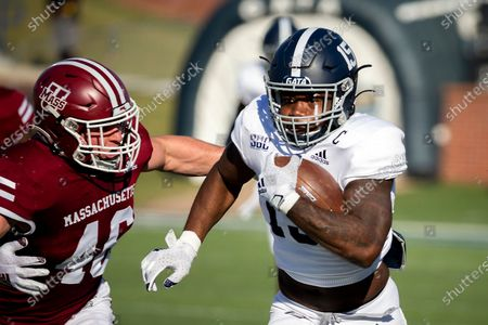 Georgia Southern running back J.D. King (15) runs away from Massachusetts linebacker Cole McCubrey (46) for a gain during the first half of an NCAA football game, in Statesboro, Ga