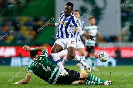 Sporting's Sebastian Coates (bottom) in action against FC Porto's Zaidu Sanusi (up) during the Portuguese First League soccer match between Sporting Lisbon and FC Porto at Alvalade Stadium in Lisbon, Portugal, 17 October 2020.