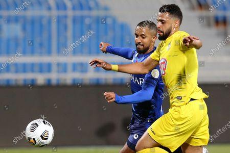 Al-Hilal's player Hattan Bahebri (L) in action against Al-Ain's Saif Hussain (R) during the Saudi Professional League soccer match between Al-Hilal and Al-Ain at Prince Faisal Bin Fahd Stadium in Riyadh, Saudi Arabia, 17 October 2020.