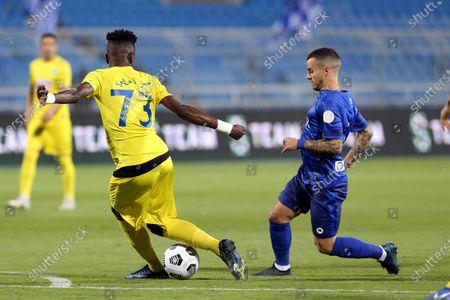 Al-Hilal's player Sebastian Giovinco (R) in action against Al-Ain's Hassan Al-Harbi (L) during the Saudi Professional League soccer match between Al-Hilal and Al-Ain at Prince Faisal Bin Fahd Stadium in Riyadh, Saudi Arabia, 17 October 2020.
