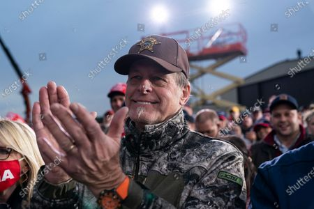 Singer songwriter Ted Nugent applauds as President Donald Trump speaks during a campaign rally at Muskegon County Airport, in Norton Shores, Mich