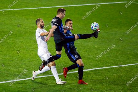 Inter Miami attacker Gonzalo Higuain, left, fights for the ball against Montreal Impact defenders Joel Waterman, center, and Rudy Camacho during an MLS soccer match, in Harrison, N.J