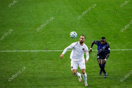 Inter Miami attacker Gonzalo Higuain, left, and Montreal Impact defender Zachary Brault-Guillard run for the ball during an MLS soccer match, in Harrison, N.J