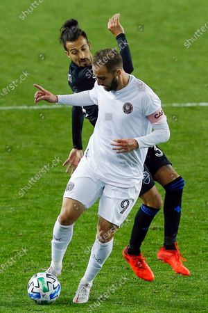 Inter Miami attacker Gonzalo Higuain, right, and Montreal Impact attacker Maximiliano Urruti, left, fight for the ball during an MLS soccer match, in Harrison, N.J