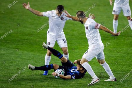 Inter Miami midfielder Dylan Nealis, left, and attacker Gonzalo Higuain, right, fight for the ball against Montreal Impact defender Rudy Camacho, center, during an MLS soccer match, in Harrison, N.J