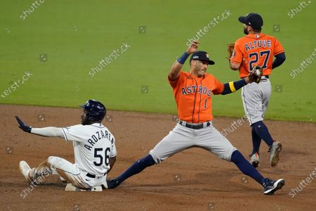 Stock Image of Tampa Bay Rays Randy Arozarena (56) is forced out by Houston Astros shortstop Carlos Correa during the third inning in Game 7 of a baseball American League Championship Series, in San Diego. At right is Houston Astros second baseman Jose Altuve