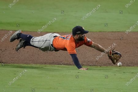 Stock Photo of Houston Astros second baseman Jose Altuve misses a single by Tampa Bay Rays' Ji-Man Choi during the sixth inning in Game 7 of a baseball American League Championship Series, in San Diego
